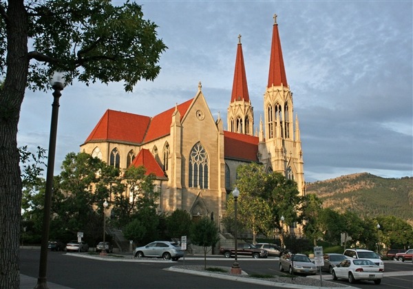 This 2011 file photo shows the Cathedral of St. Helena in Helena, Mont. The Roman Catholic Diocese of Helena was filing for bankruptcy protection Friday in advance of proposed settlements for two lawsuits that claim clergy members sexually abused 362 people over decades and the church covered it up.