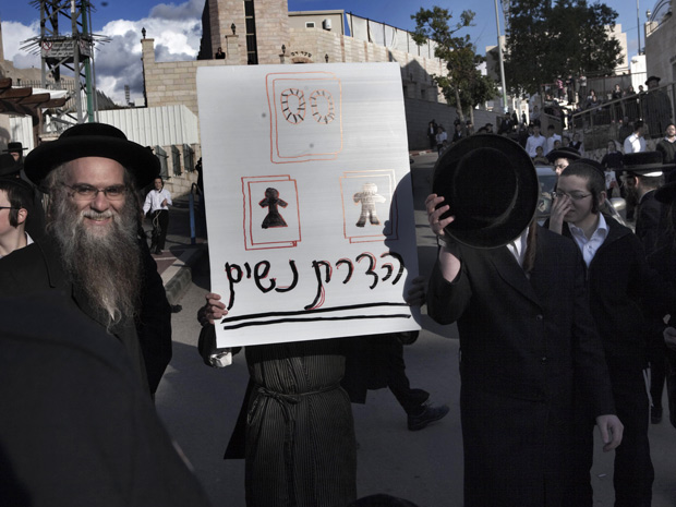Ultra Orthodox Jews hold a placard that reads in Hebrew