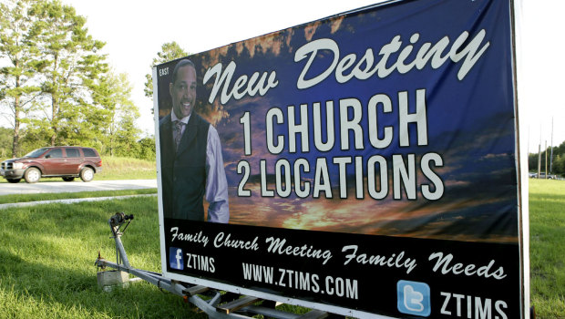 A sign with a photo of Pastor Zachery Tims is seen near the street at the New Destiny Christian Center in Apopka, Fla., Monday, Aug. 15, 2011. (AP Photo)
