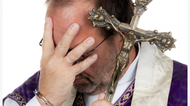 [image of priest in handcuffs via Shutterstock.com]