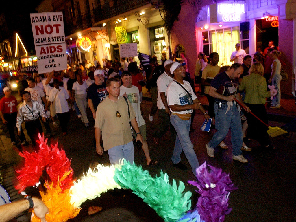 The Rev. Grant Storms right, uses a broom as he leads his anti-Southern Decadence parade on Bourbon Street in August 2003.