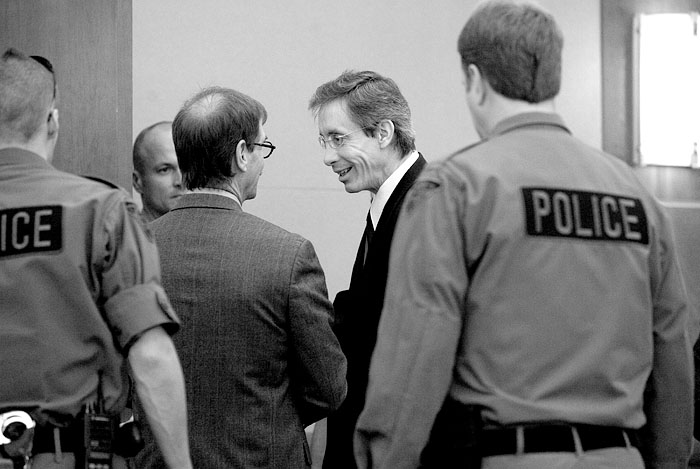 As Jeffs was escorted out, Jeffs had a smile and a few words with attorney Walter Bugden